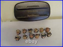 Royal Doulton Charles Dickens Commemorative set of 12 Tiny character jugs + stan